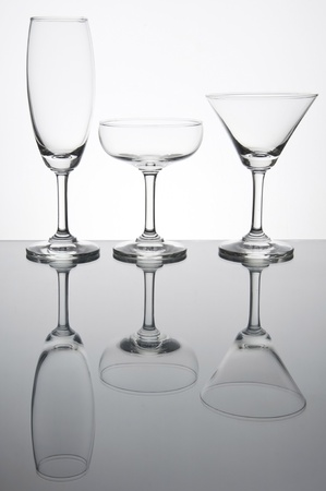 Empty glass with reflection as white isolate background photo