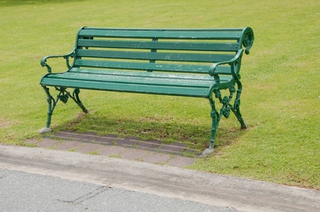 chair in the park as green grass color photo