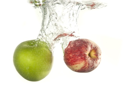 fruit drop: apple fruit drop in water as white isolate background