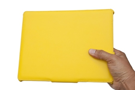Yellow notebook and hand as white isolate background photo