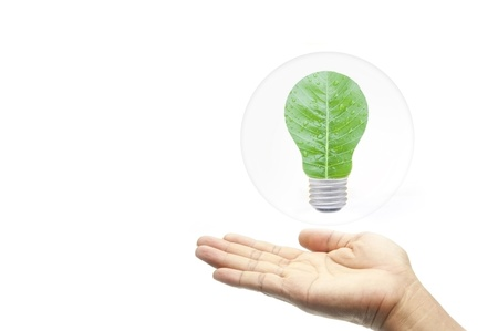 green energy concept hand with leaf in bubbles as white isolate background photo