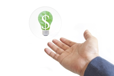 hand and green energy lamp in white isolate background photo