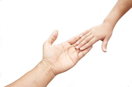 touching hands: father hand and child hand as white isolate background