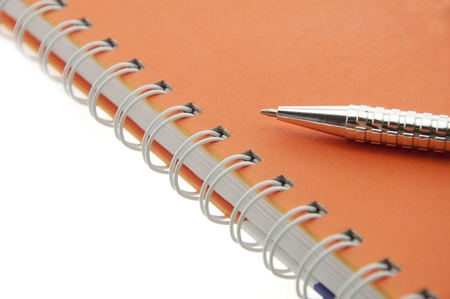 pen push on notebook as white isolate background photo