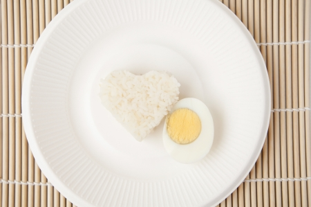 rice heart and egg as bamboo wooden photo