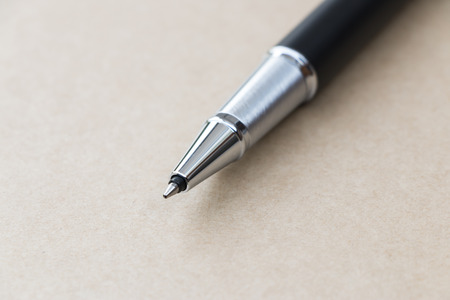 Black pen on brown paper colour photo
