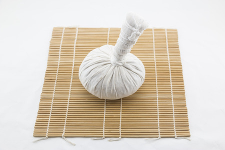 herbe: Thai herbe massage ball on bamboo wooden