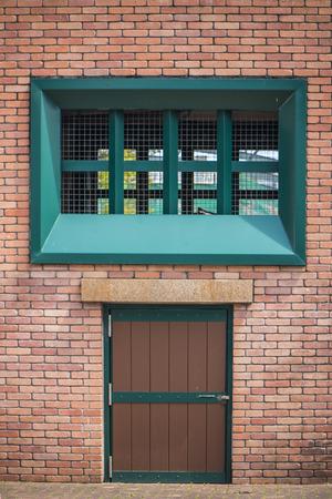 green door: Green door color as brickwall