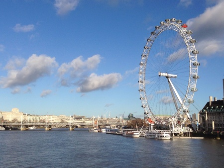 eye: London eye among blue sky Stock Photo