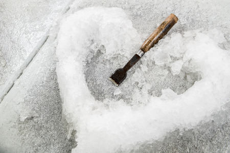ice in heart shaped and chisel photo