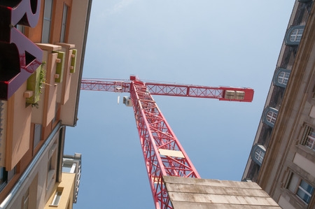 statics: Red crane on construction site Stock Photo