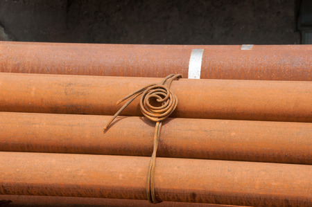 steel pipes: Wire node on steel pipes Stock Photo