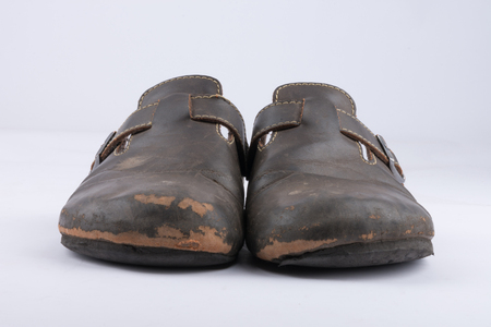 Old leather slippers that are heavily used Stock Photo
