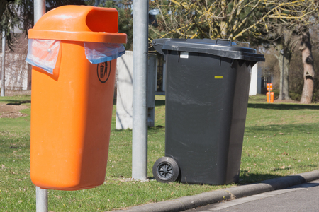 Different garbage cans for dog droppings and residual waste