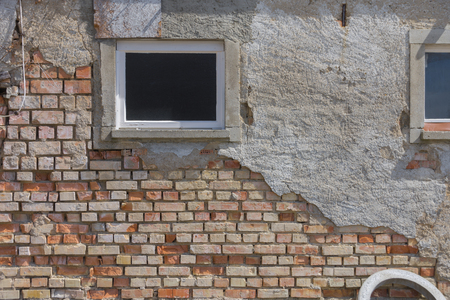 Old brick masonry with window and cement plaster Archivio Fotografico - 106955536