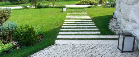 Symmetrical balance in garden design, formal landscape style with clean lines and crisp angles.