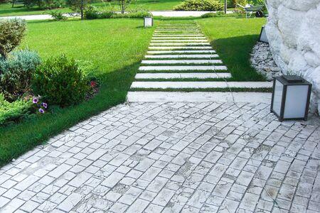 Road in the garden. View of garden plot, estate landscape design