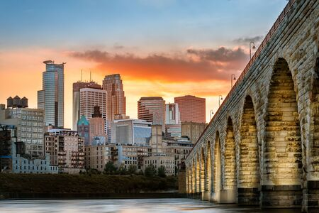 Stone Arch Bridge lights in Minneapolis at sunset Stock fotó