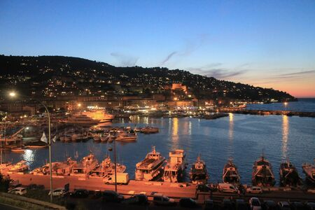 Sunset in Porto Santo Stefano, Tuscany Italy. View of the harbour. Copy space.