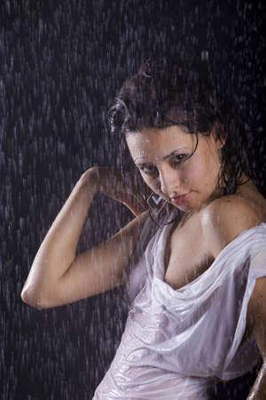 young caucasian brunette girl under rain photo