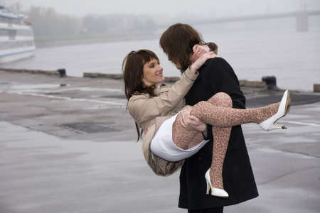 sexy wife: young romantic couple under rain
