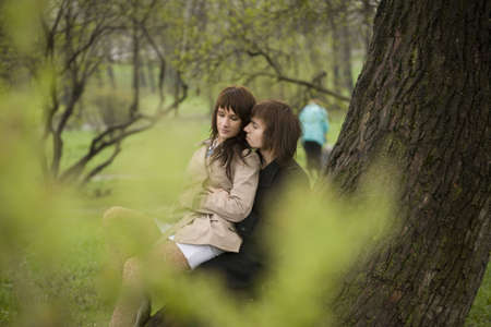 young couple outdoor in the park photo