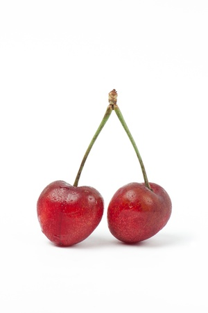 Two sweet Cherries isolated on white background