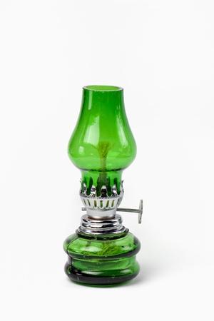 oillamp: green kerosene lamp isolated on white background