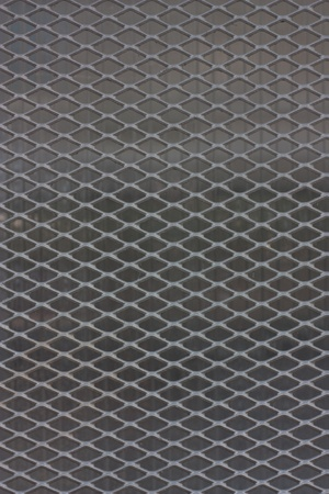 Chain link fence on gray background