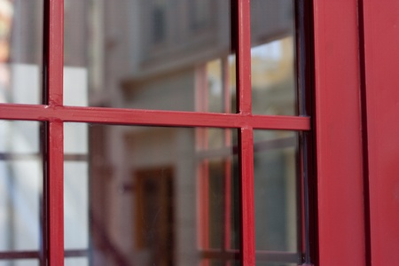pay wall: window of red telephone booth, close up Stock Photo