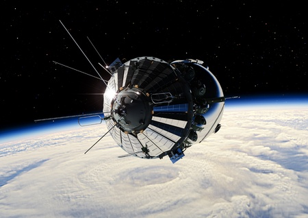 The first spaceship at the Earth orbit Stock Photo - 12870344