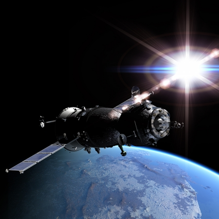 Spaceship at the Earth orbit Stock Photo