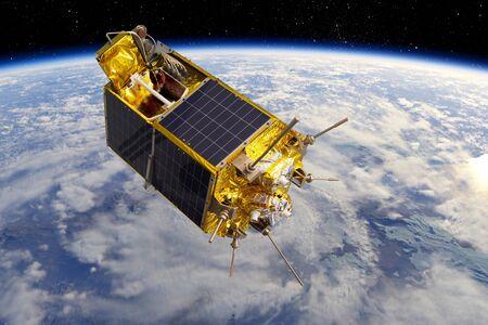 Moderno satélite espacial científico y educativo en órbita Foto de archivo