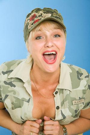 hard core: blond model in khaki uniform poses in studio Stock Photo