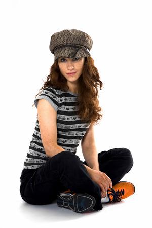 kepi: The red-haired model posing in studio