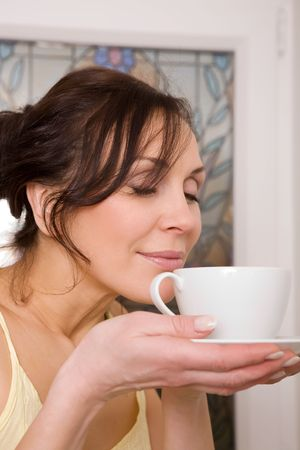 young woman enjoying a cup of tea Stock Photo - 2788716