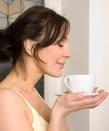 young woman enjoying a cup of tea Stock Photo - 2788710