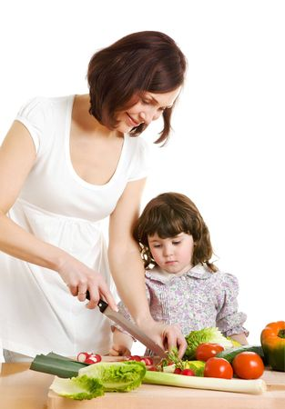 mother and daughter cooking salad at the kitchen Stock Photo - 2954286