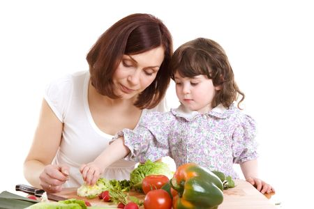 mother and daughter cooking salad at the kitchen Stock Photo - 2954288