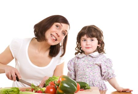 mother and daughter cooking salad at the kitchen Stock Photo - 2954287