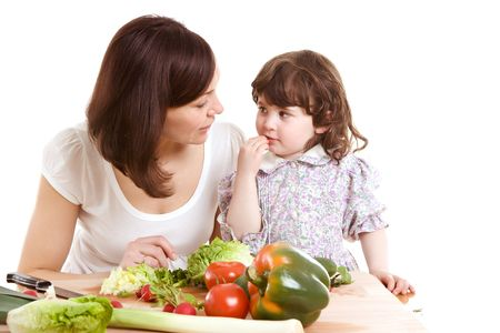 mother and daughter cooking salad at the kitchen Stock Photo - 2981286