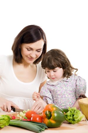 mother and daughter cooking salad at the kitchen Stock Photo - 2981290