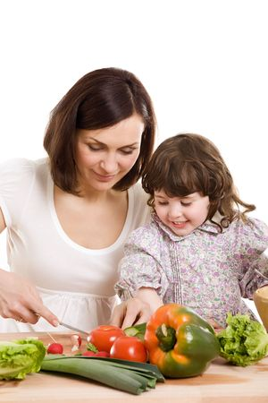 mother and daughter cooking salad at the kitchen Stock Photo - 2981287
