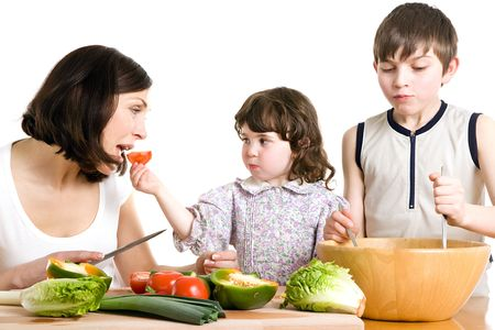 mother and children cooking salad at the kitchen Stock Photo - 2981309