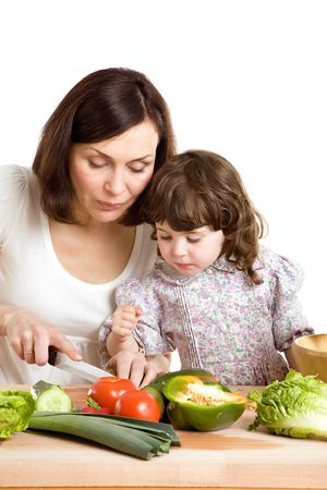 mother and daughter cooking salad at the kitchen Stock Photo - 2981310