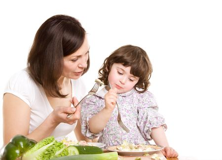 mother and daughter cooking salad at the kitchen Stock Photo - 2981305