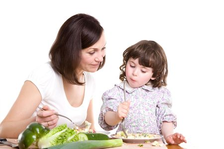 mother and daughter cooking salad at the kitchen Stock Photo - 3001494