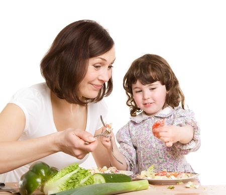 mother and daughter cooking salad at the kitchen Stock Photo - 3168514