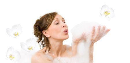Attractive woman enjoys in the bathtub