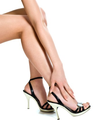 Beautiful legs in black shoes isolated on white background photo